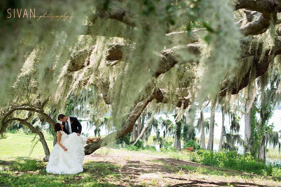 Couple Kissing Under Oak at Orlando Waterfront Ceremony