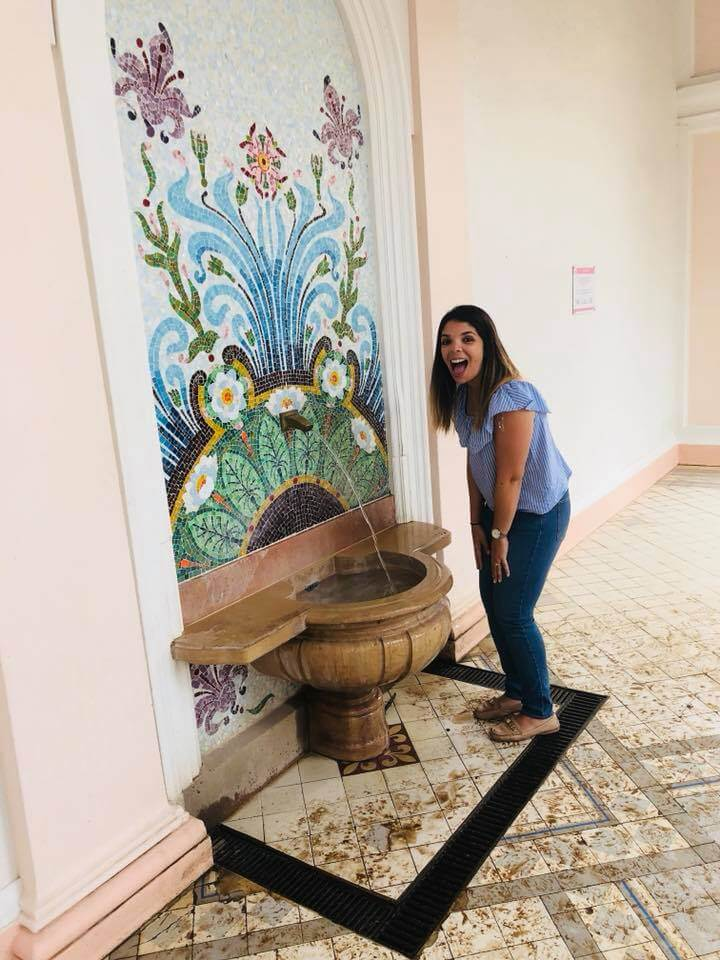Girl excited at the evian drinking fountain in France