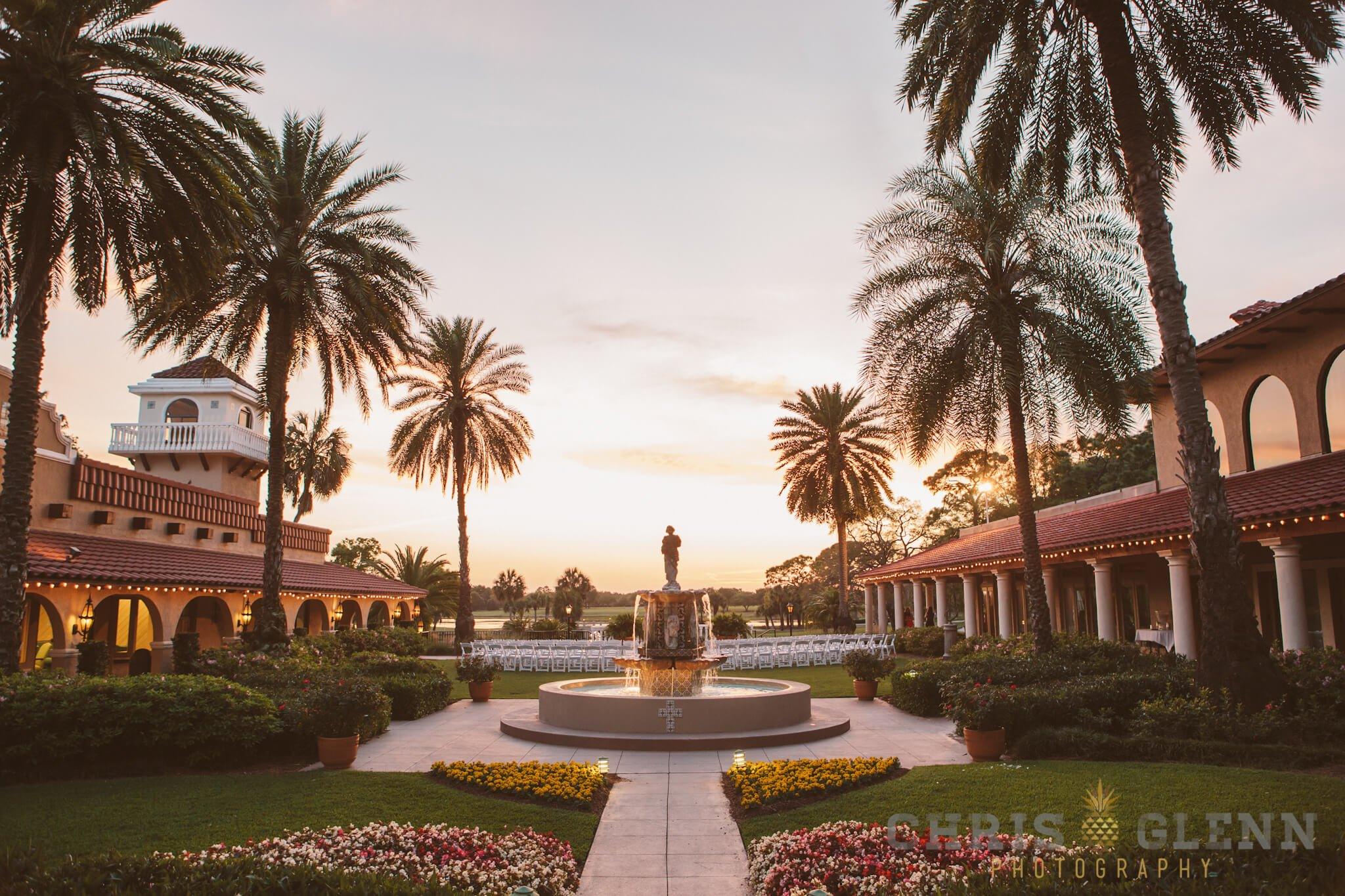 Central Florida sunset behind Plaza de la Fontana garden ceremony space by Chris Glenn Photography