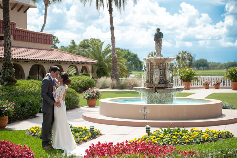 Plaza de la Fontana Fountain with Bride and Groom with Red and Yellow Floral