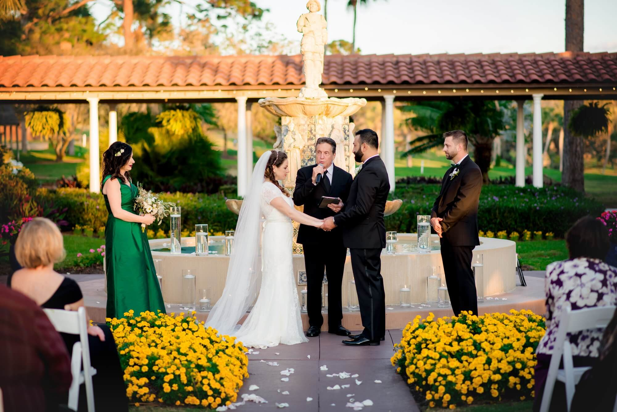 Wedding Ceremony with Fountain Backdrop framed by yellow flowers