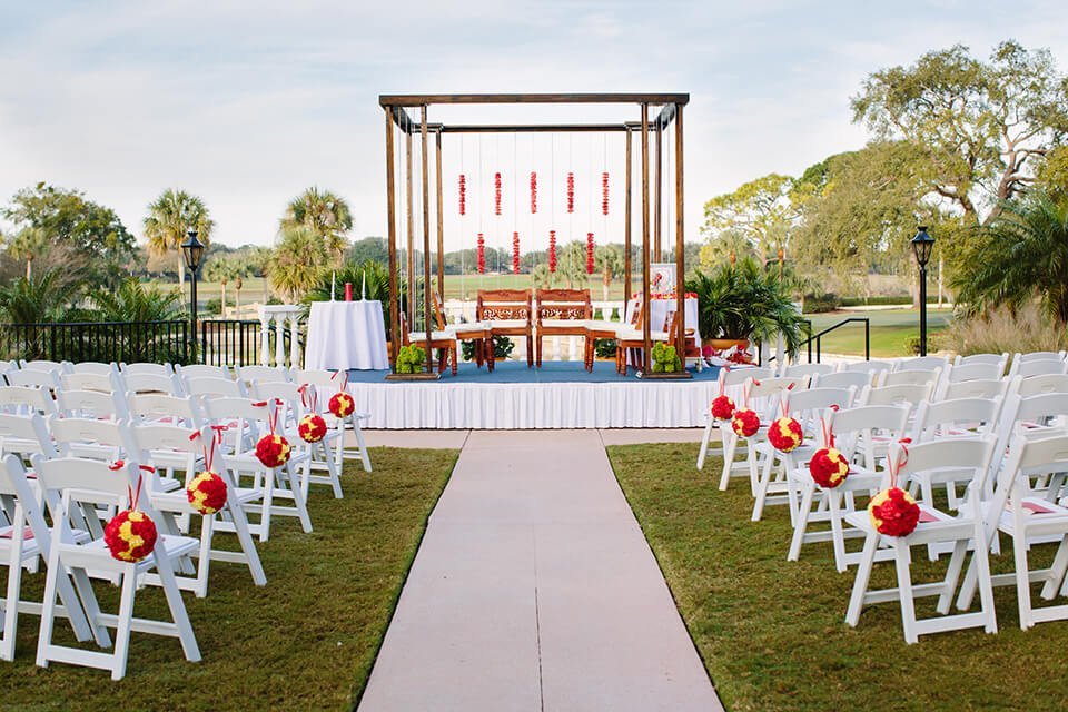 Mandap on Plaza de la Fontana for Indian Wedding Ceremony with Red and Gold Decor